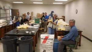 Volunteers gathered to prepare yard-size packages of fire ant sterilant, complete with application instructions.
